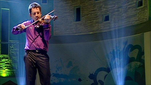 Oliver Lewis plays violin on Blue Peter