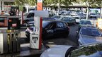 Cars queue for petrol at a petrol station in Paris