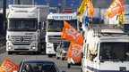 French lorry drivers demonstrate over pension reform on a motorway near Fresnes-les-Montauban, northern France