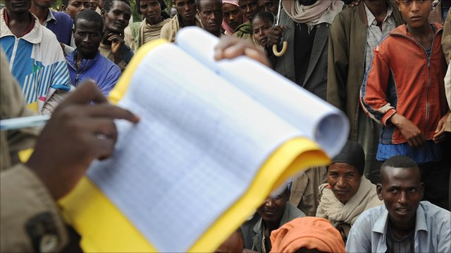 People waiting for their names to be called at an aid distribution centre