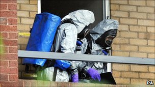 Officers in chemical suits at the flat in Putney on 30 September