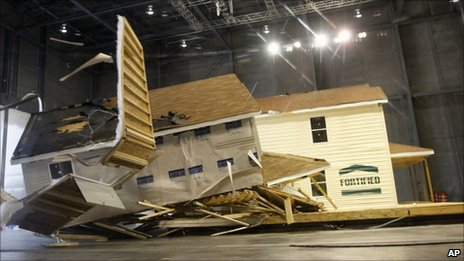 Damage after two homes are pounded by a simulated hurricane