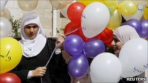 Islamic Action Front activists with balloons in front of their headquarters in Amman, 16 October
