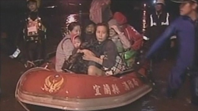 People being rescued from flood