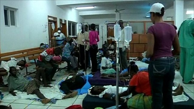 Patients in medical facility lying on floor and benches