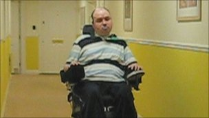 Jamie Merrett in his wheelchair