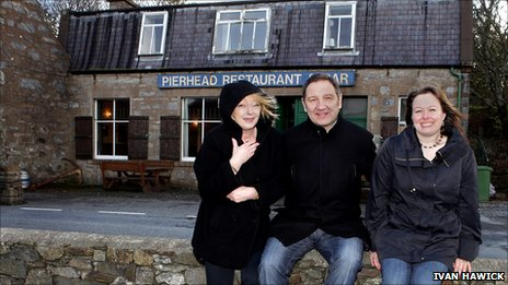 Jim Brown with Pierhead staff including Denise Anderson (right) / [Pic: Ivan Hawick]