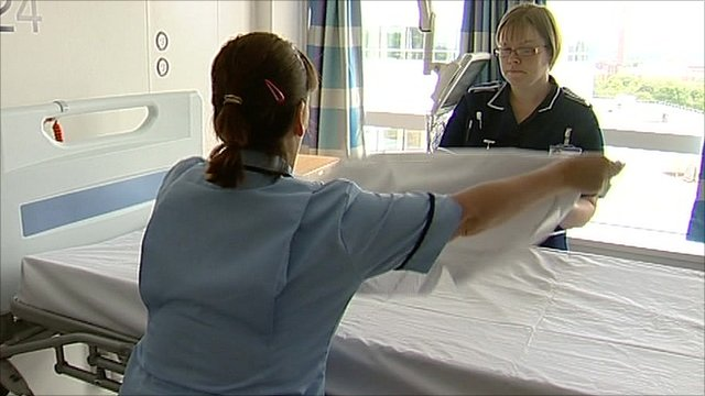 Nurse making a bed in a hospital