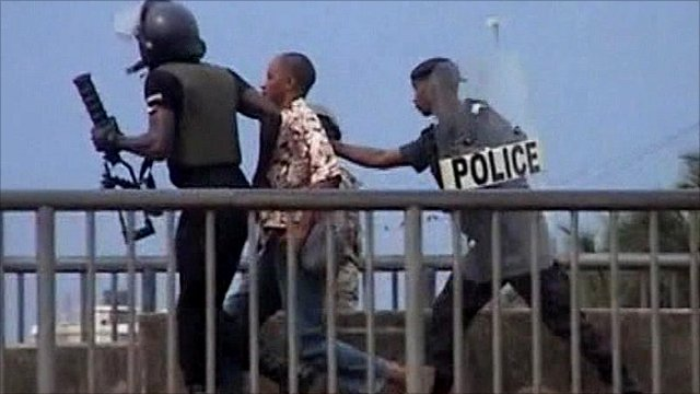 Protester with police in Guinea
