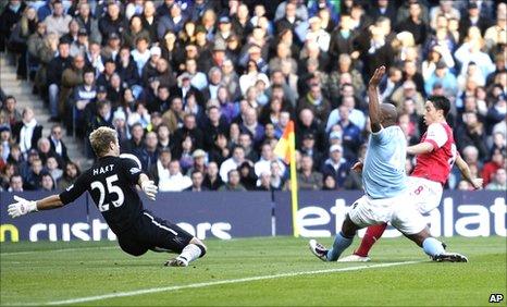 Samir Nasri scores Arsenal's opening goal against Manchester City