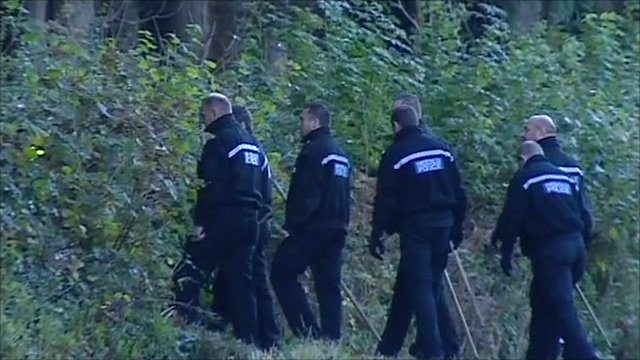 Police search woodland