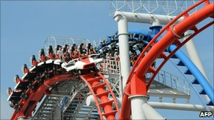 "Photo taken on March 18, 2010 shows visitors riding on the ""Battlestar Galactica roller-coaster"" at Universal Studios Singapore theme park during its opening day in Singapore"
