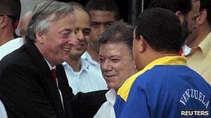 Nestor Kirchner with Colombia's president Juan Manuel Santos (middle) and Venezuelan leader Hugo Chavez (right) in Santa Marta, Colombia, August 2010