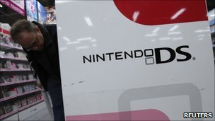 Man looking at Nintendo products in a store in Tokyo