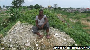Former resident sits on the rubble that is her former home at Njemanze, in Port Harcourt