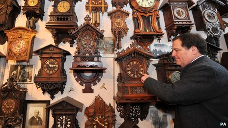 Man moving clock hand