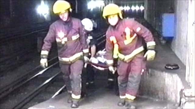 Firefighters carrying stretcher during 7/7 bombings