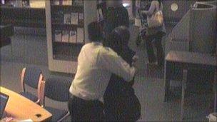 Roshonara Choudhry being restrained