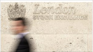 Man walks past London Stock Exchange