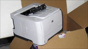 Photo released by Dubai police of what they said was printer containing ink cartridge loaded with bomb - released 30 October 2010