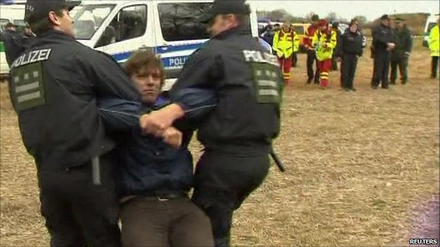 Protester being taken away by police