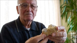 Dr Izzettin Baris holding a piece of erionite
