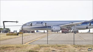 The 787 is examined by emergency services and investigators