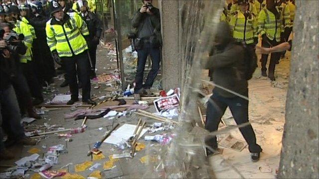 Demonstrators smashing window