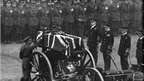King George V placing a wreath on the coffin of the unknown warrior, at the Cenotaph.