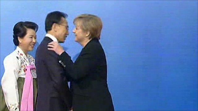 Angela Merkel embraces her counterpart