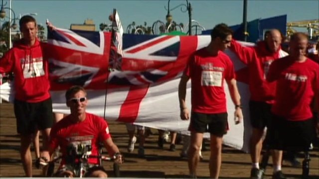 The servicemen cross the finishing line
