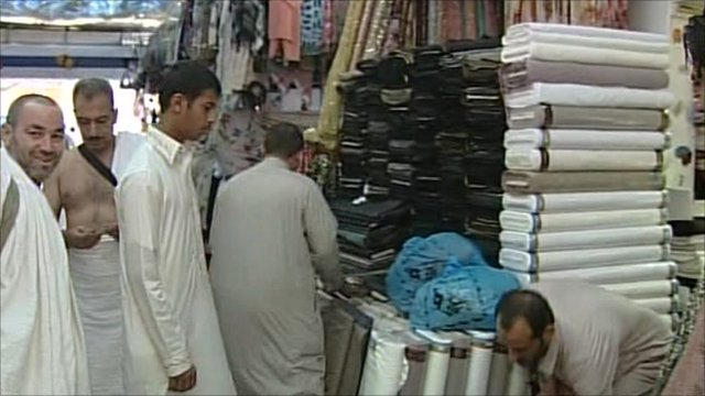 Men eye up cloth in the market