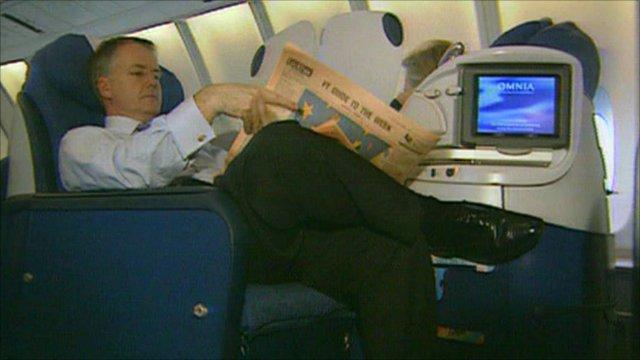 A passenger relaxes in business class