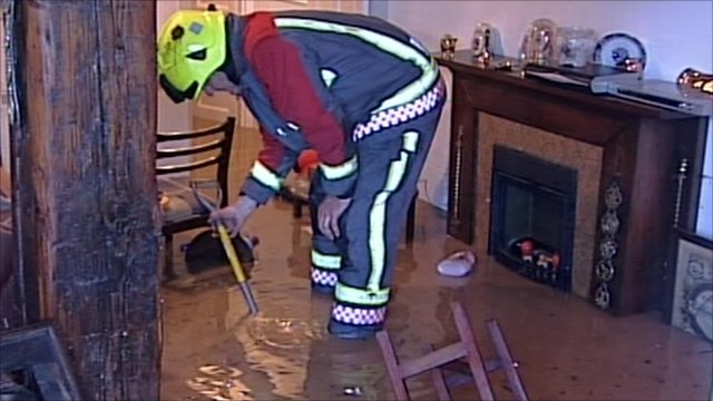 Fireman inside flooded house
