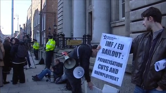 A man protests the bail-out proposals