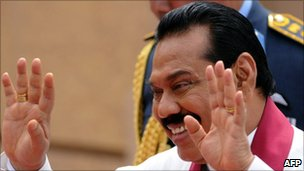Mr Rajapaksa greets supporters at the swearing-in ceremony