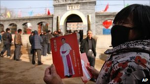 A woman shows a leaflet with picture of Guo Jincai in Chengde. Photo: 20 November 2010