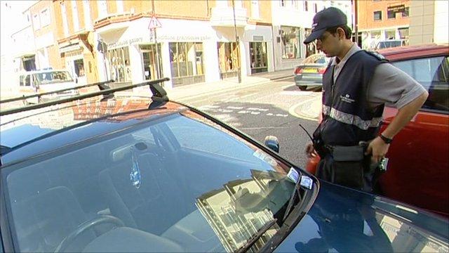 Parking inspector near a parked car