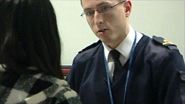Customs officer doing interview