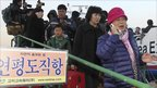 Residents of the South Korean Yeonpyeong Island arrive having taken the ferry to the mainland port of Incheon.