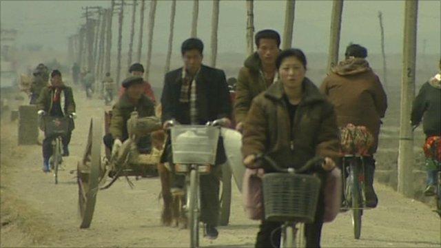 North Korean people on bicycles
