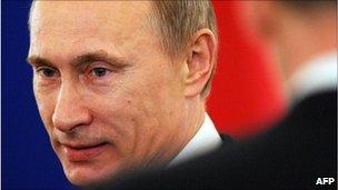 Russian Prime Minister Vladimir Putin arrives for President Medvedev's speech, 30 November