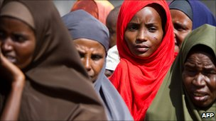 Somali women wait in line at a checkpoint for medical care provided by the African Union mission in Somalia, January 2010
