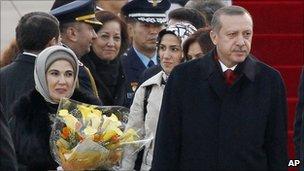 Turkey's Prime Minister Recep Tayyip Erdogan (R) and his wife Emine Erdogan