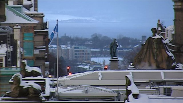 Scottish flag flying in city