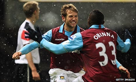Jonathan Spector celebrates with Victor Obinna