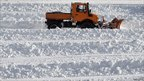 A worker removes snow from a car park in Spitzingsee, southern Germany, 30 November