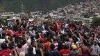 President Hugo Chavez addressing inhabitants in a rain-affected area of Caracas