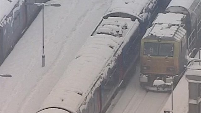 Trains covered in snow