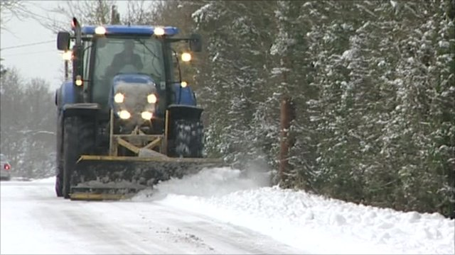 Tractor clearing snow